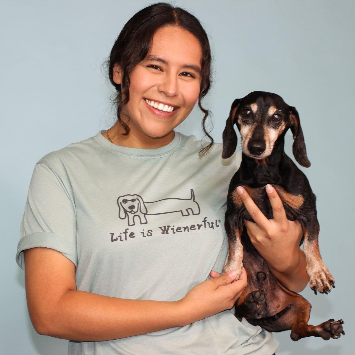 woman wearing custom tee shirt holding a dog
