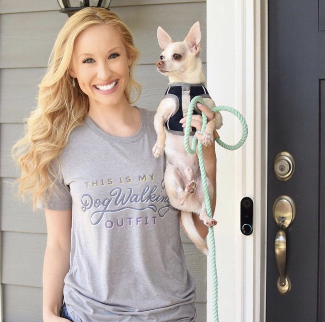 smiling woman holding dog