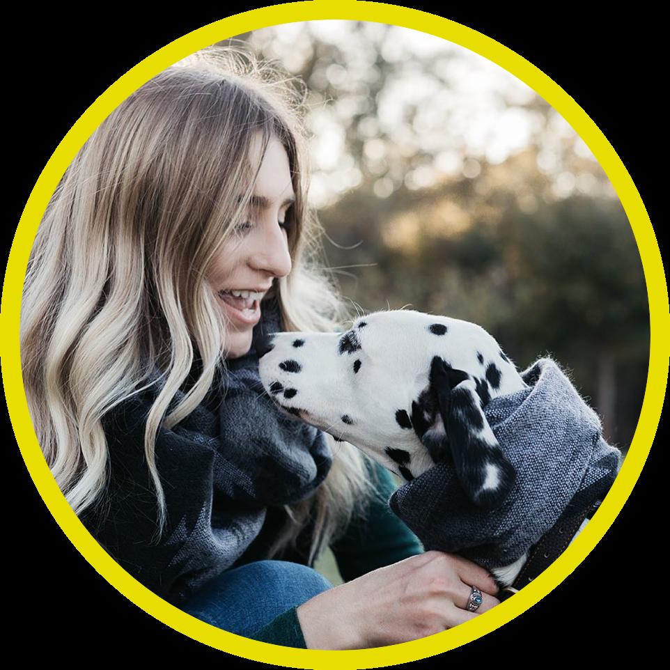 Woman smiling at Dalmatian