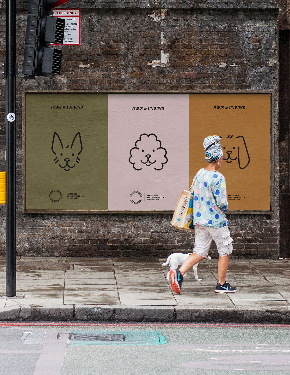 person and dog walking past three dog illustration posters on the street