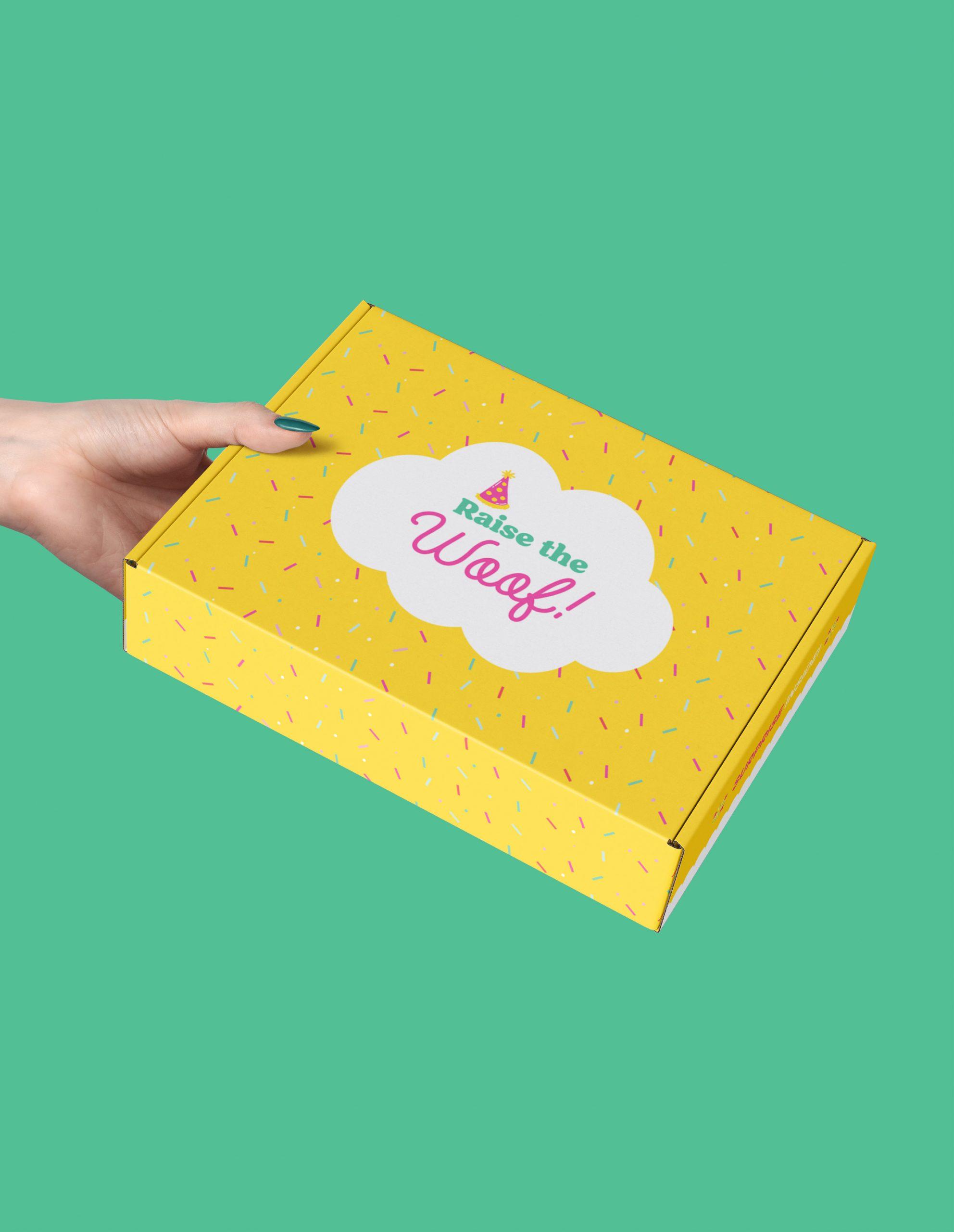 hand holding yellow gift box