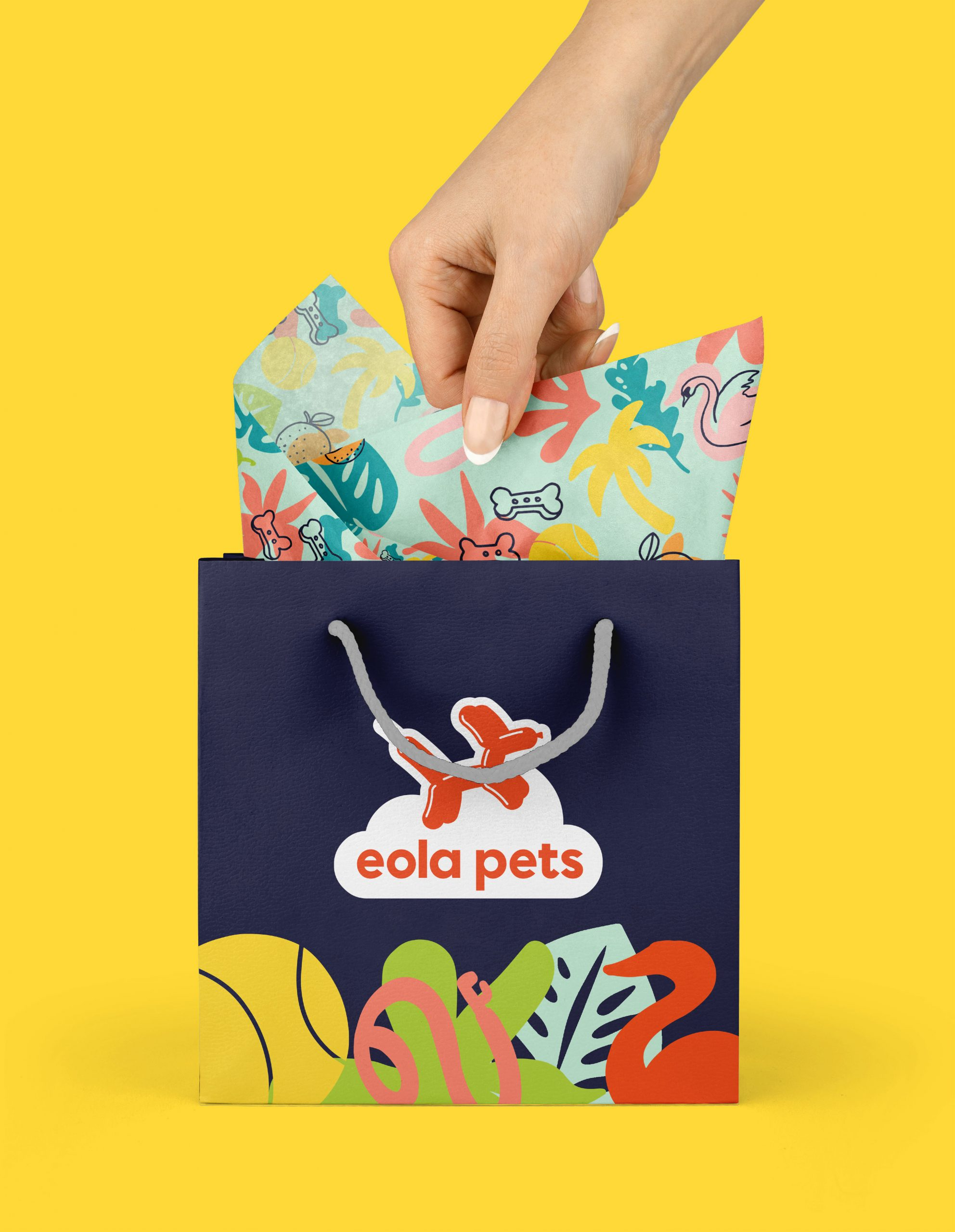 Hand reaching into Eola Pets gift bag