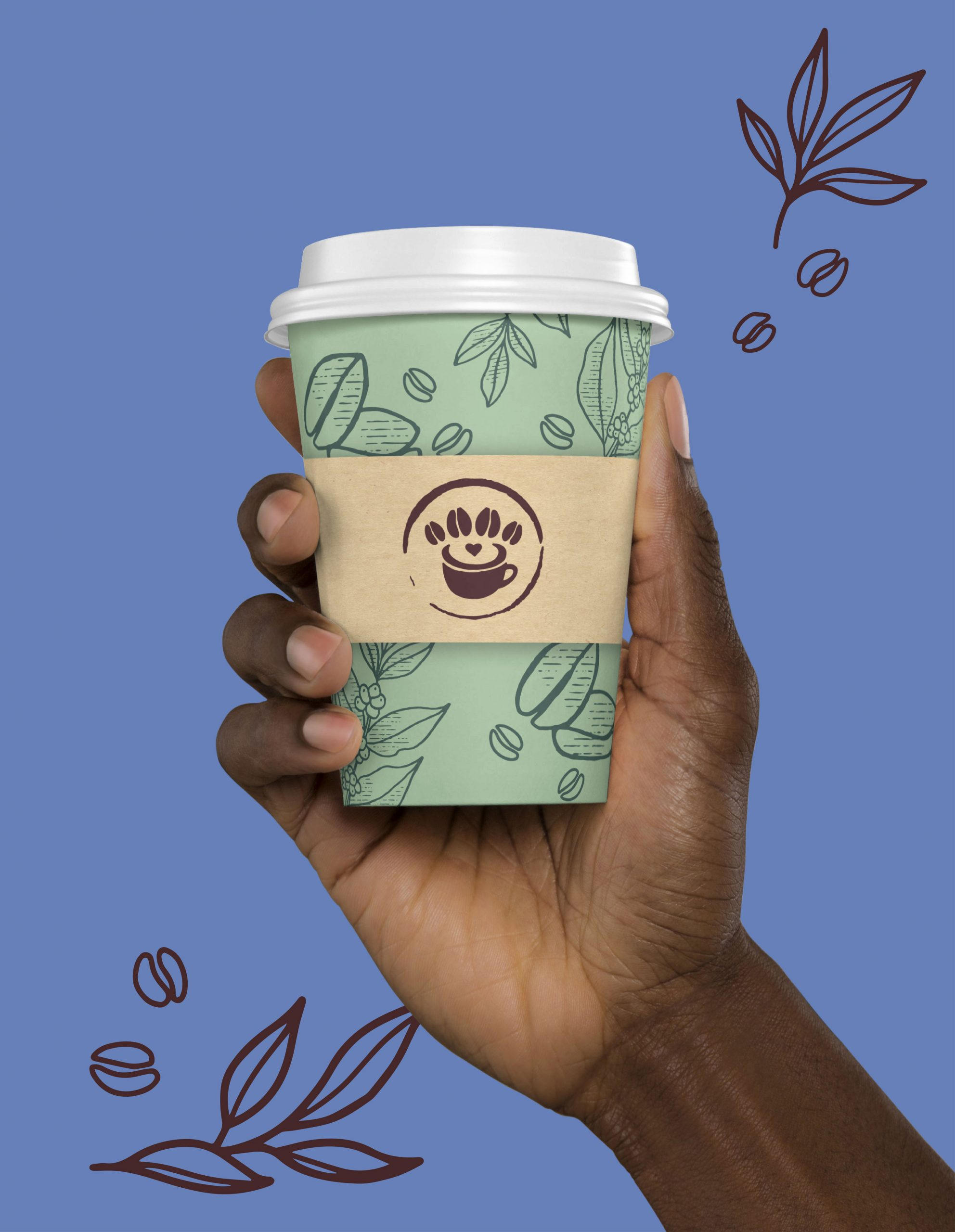 hand holding a to-go coffee cup
