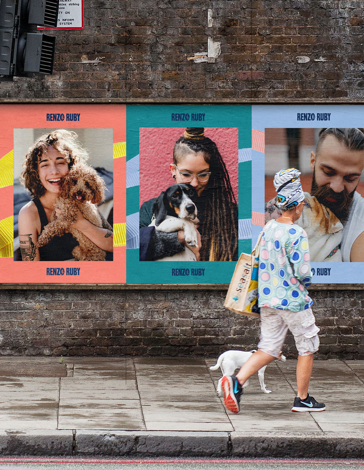 person walking dog past dog lover posters on brick wall